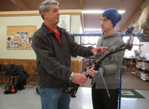 Owner, Chuck Pedracini  showing a new student how to hold the bow